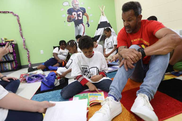 NFL Hall Of Famer Helps Build Reading Room At PB&GC